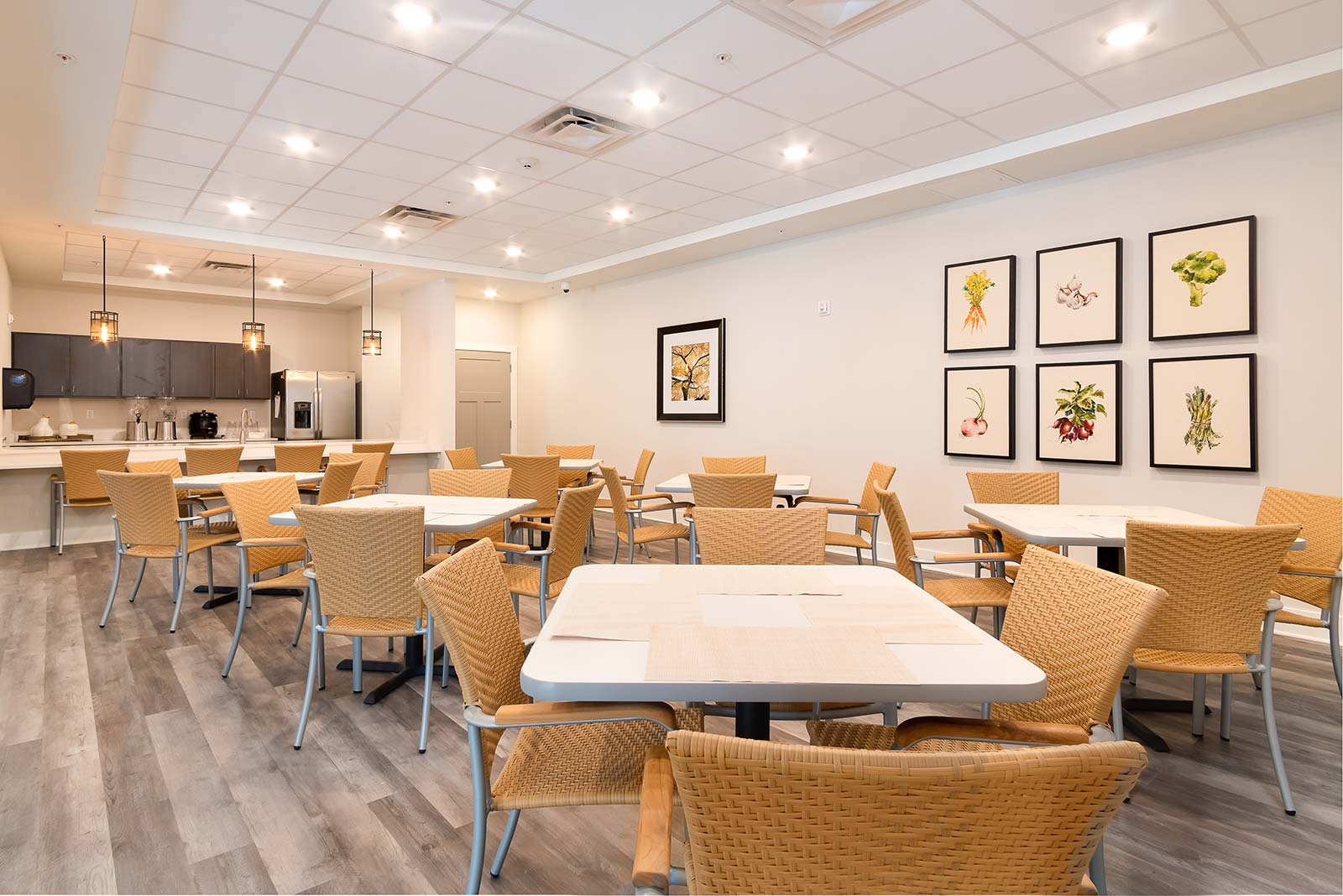 Bistro eating area with tables and chairs in our Plant City FL assisted living and memory care community