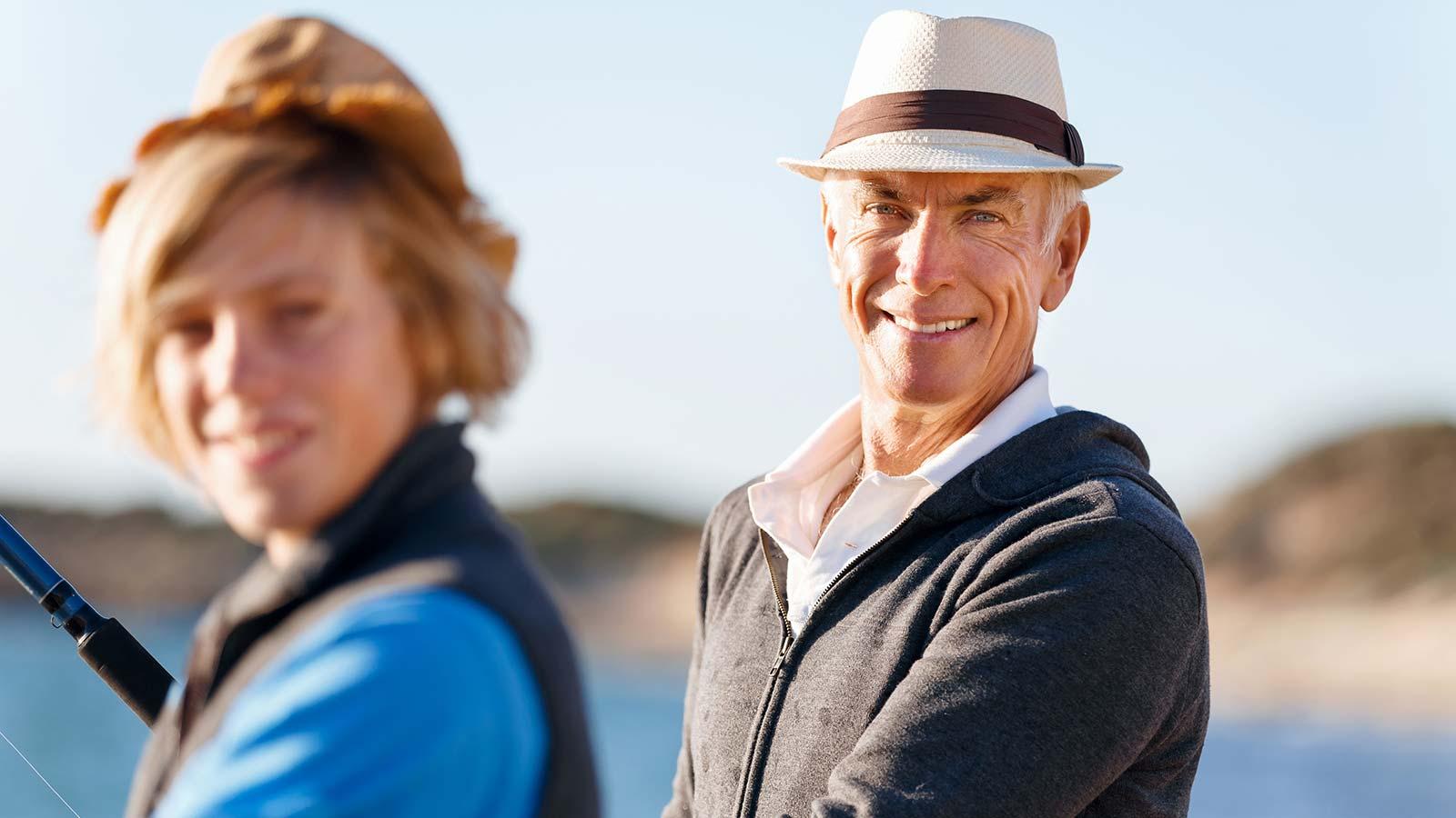 Senior man and woman facing camera